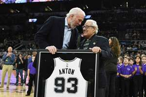 Peter Anton, 93, was honored for his 46 years of service with a game jersey by coach Gregg Popovich before the team's game with the New Orleans Pelicans in the AT&T Center on Feb. 2, 2019.