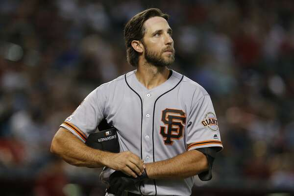San Francisco Giants starting pitcher Madison Bumgarner (40) in the first inning during a baseball game against the Arizona Diamondbacks, Sunday, Aug. 18, 2019, in Phoenix. (AP Photo/Rick Scuteri)
