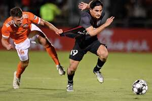 San Antonio FC midfielder Cristian Parano, who scored a goal just before halftime, has his jersey pulled by Rio Grande Valley FC defender Zachary Jackson during the teams' 2-2 draw.