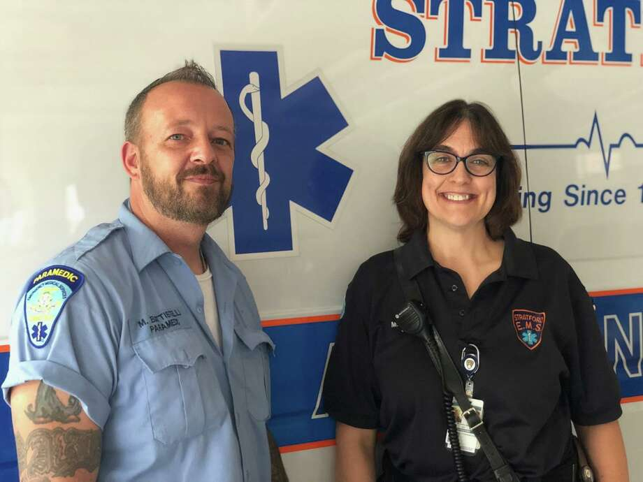Paramedic Mike Battistelli and emergency medical technician Michelle Edler from Stratford EMS helped a man suffering from heat stroke on a Short Beach ball field on Sunday. Photo: Stratford EMS / Contributed