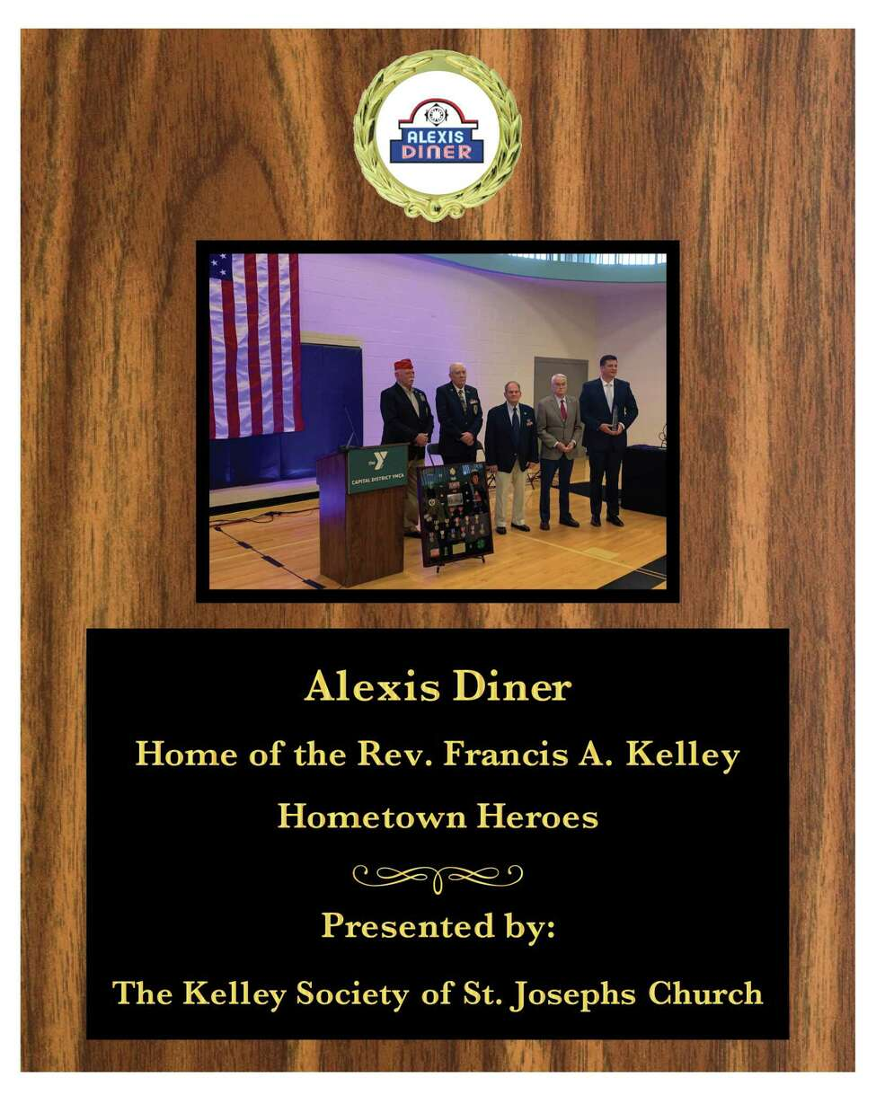 John Mullen presented this plague on behalf of the Rev. Francis A. Kelley Society of St. Josepha€™s Church, Troy, to the owners of Alexis Alexis Diner in Troy. Several of the societya€™s Hometown Heros are pictured on the plague. (Rev. Francis Kelley Society)