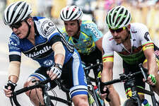 Riders Saturday keep close on a sharp turn during the Edwardsville Rotary Criterium Festival.