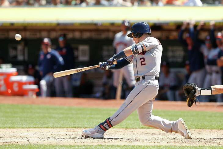 OAKLAND, CALIFORNIA - AUGUST 18: Alex Bregman #2 of the Houston Astros hits a three-run home run in the top of the fifth inning against the Houston Astros at Ring Central Coliseum on August 18, 2019 in Oakland, California.