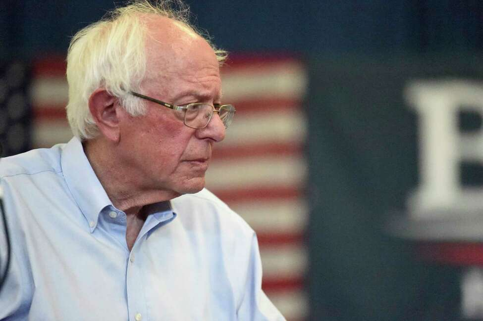 Democratic presidential hopeful Bernie Sanders looks on as panel members discuss his criminal justice reform plan during a town hall meeting on Sunday, Aug. 18, 2019, in Columbia, S.C. (AP Photo/Meg Kinnard)
