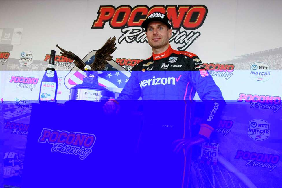 Will Power poses with the trophy after winning an IndyCar Series auto race at Pocono Raceway, Sunday, Aug. 18, 2019, in Long Pond, Pa. (AP Photo/Matt Slocum)