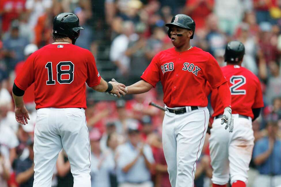 Boston Red Sox's Rafael Devers, front right, celebrates his two-run home run that also drove in Mitch Moreland (18) during the seventh inning of a baseball game against the Baltimore Orioles in Boston, Sunday, Aug. 18, 2019. (AP Photo/Michael Dwyer)