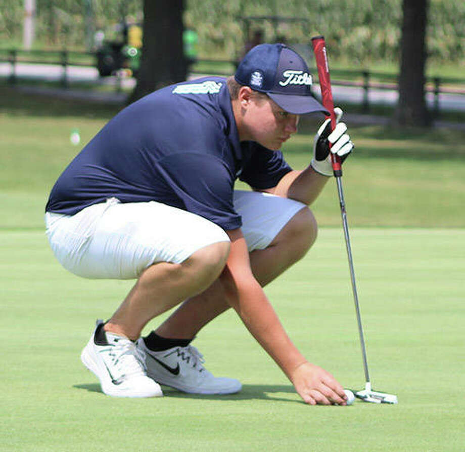 Jersey's Davis Hamm places the ball for his putt on the 18th green during EA-WR's Hickory Stick Invitational last season at Belk Park in Wood River. Hamm is expected back at Belk on Monday to lead the Panthers in the 2019 Hickory Stick. Photo: Greg Shashack / Telegraph File Photo