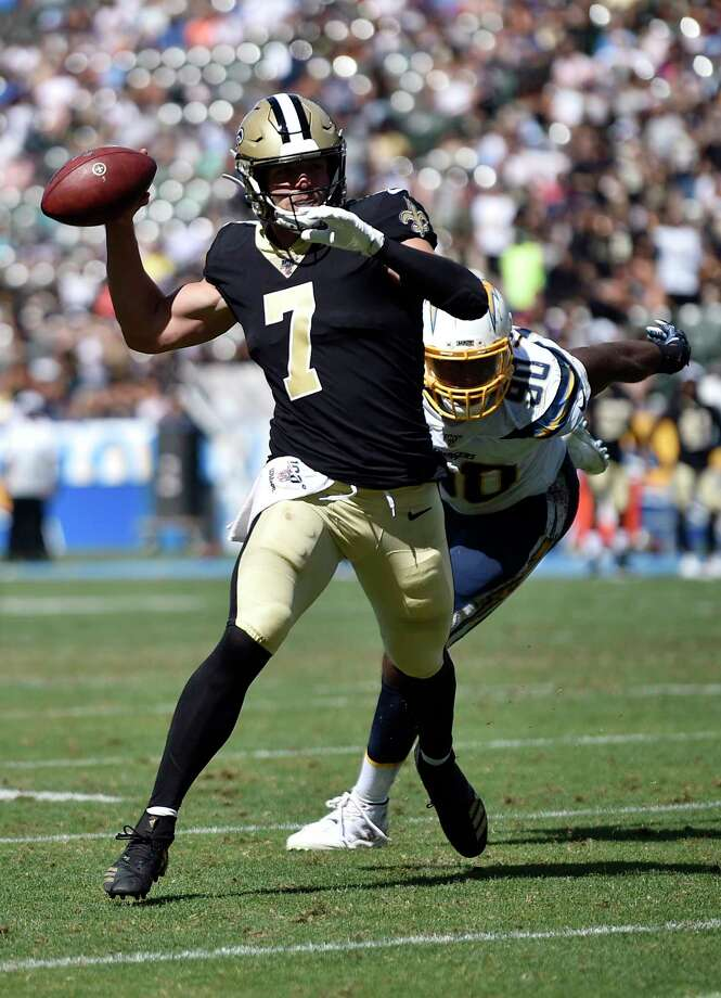 New Orleans Saints quarterback Taysom Hill, left, throws under pressure from Los Angeles Chargers defensive end Anthony Lanier during the second half of a preseason NFL football game Sunday, Aug. 18, 2019, in Carson, Calif. (AP Photo/Kelvin Kuo) Photo: Kelvin Kuo / 2017 Kelvin Kuo Photography