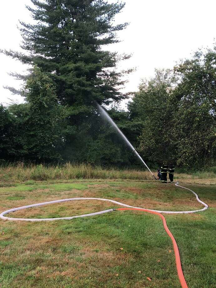 Firefighters in Litchfield County were busy Sunday evening on Aug. 18, 2019 after storms led to three lightning strikes, officials said. The Bantam Fire Company then moved on to deal with a tree that had been set on fire by a lightning strike on Stoddard Road, officials. During the same period, Bantam emergency responders dealt with two separate EMS calls that required patients to be transported, officials said. Photo: Bantam Fire Company Photo