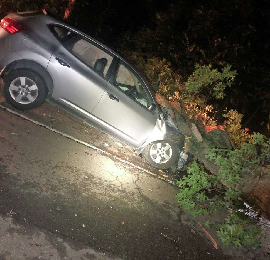 Two people were injured after a tree fell on a vehicle on Route 80 on Sunday, Aug. 18, 2019. Photo: East Haven Police Photo