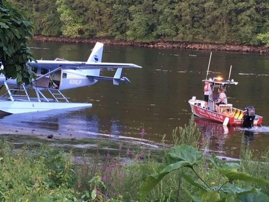 Shelton fire crews aided in handling an emergency aircraft landing on the Housatonic River on Friday, Aug. 16. Photo: Shelton Fire Department / Contributed Photo / Connecticut Post