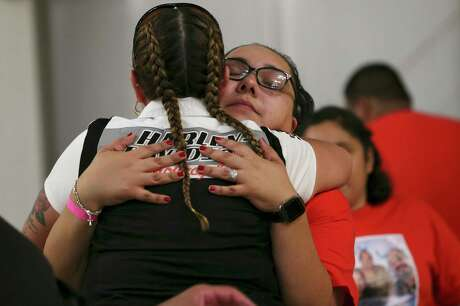 Maria Flores, left, hugs her cousin, Erica Solis, 33, during a benefit concert for funeral expenses for the Gonzalez family at the South Side Expo Hall on Pleasanton Road, Sunday, Aug. 18, 2019. Solis is the daughter of triple suicide/murder victim, Josefina ÒJosieÓ Gonzalez, 67, uncle, Jose Guadalupe Hurtado Guillen, 56, and grandmother, Felicitas Guillen Gonzalez, 85. Ruben H. Gonzalez, 28, SolisÕ brother, murdered them on Aug. 5. He set fire to the house on 7500 block of Dream Valley before killing himself.  Several bands performed and among them were, David Lee Garza y Los Musicales, Los Desperadoz, and Joey Martinez.
