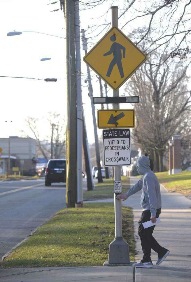 A pedestrian prepares to cross White Street in Danbury in December 2018. Photo: H John Voorhees III / Hearst Connecticut Media