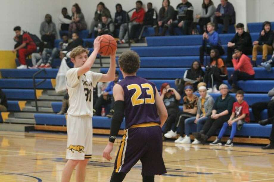 Baldwin's Bryce Masterman (left) looks to make a pass against Pentwater/