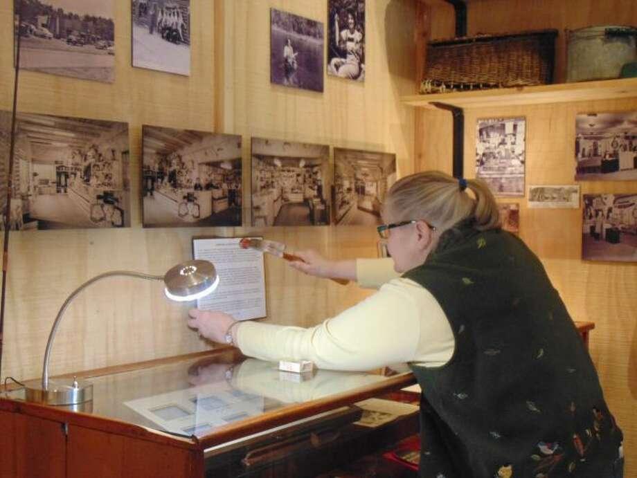 "Museum curator Jill Engelman hammers up information on famous fly tier, Josephine ""Jo"" Sedlecky-Borsum"