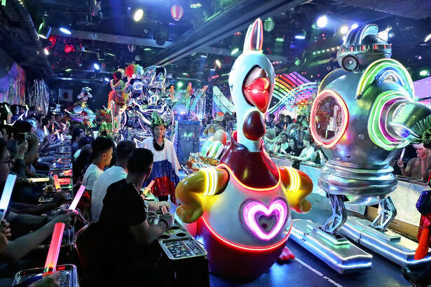 Tourists at the at the Robot Restaurant in Tokyo.