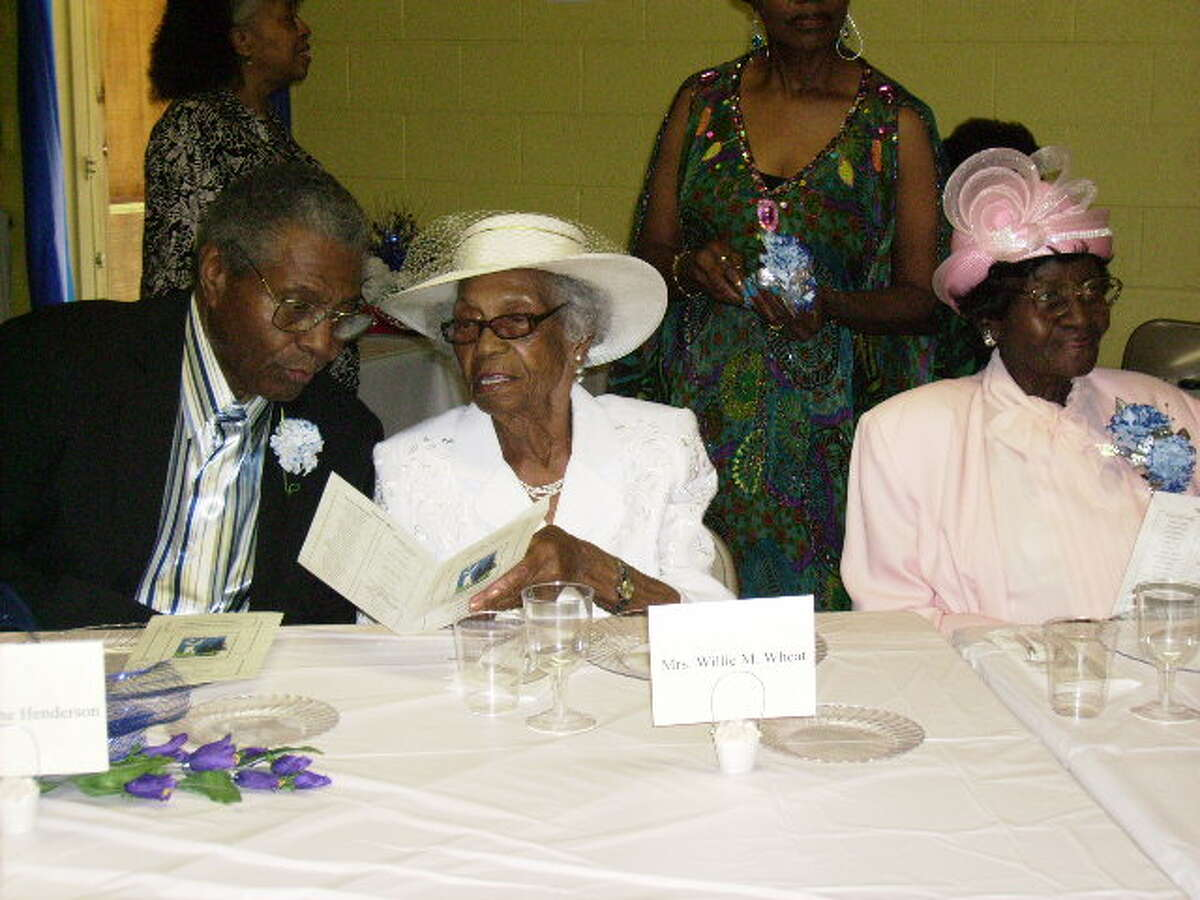 Mrs. Georgia Barbee (right) chats with other honorees. (Photo/Ann Walters)