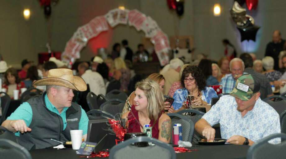 Supporters of the Montgomery County Fair & Rodeo gathered during the organization's annual appreciation dinner at the Lone Star Convention & Expo Center on Saturday. Photo: Jason Fochtman, Houston Chronicle / Staff Photographer / Houston Chronicle