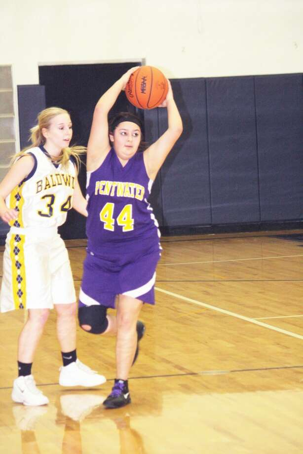 DEFENSE MATTERS: Kaitlyn Smith (34) plays defense for Baldwin's girls basketball team in recent action. (File photo)