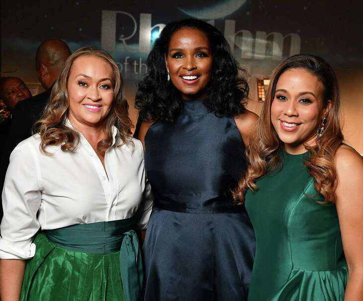 """EMBARGOED FOR SOCIETY REPORTER UNTIL AUG 20 2019  Chair Winell Herron,center, with co-chairs Gaynell Drexler, at left, and Heidi Smith, at right, at the Ensemble Theatre's annual celebrity gala """"Rhythm of the Night"""" at the Hilton Americas Hotel Saturday Aug. 17,2019.(Dave Rossman Photo)"""