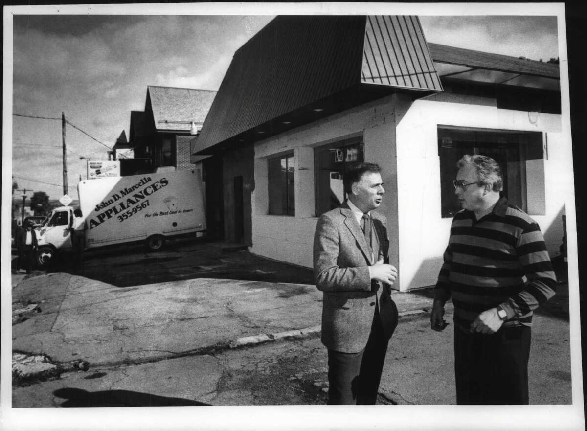 Crane Street, Schenectady, New York - David Faulkner Undated (left) and John Marcella discuss changing look of Crane Street's business section in front of Marcella's new store. October 09, 1987 (John Carl D'Annibale/Times Union Archive)