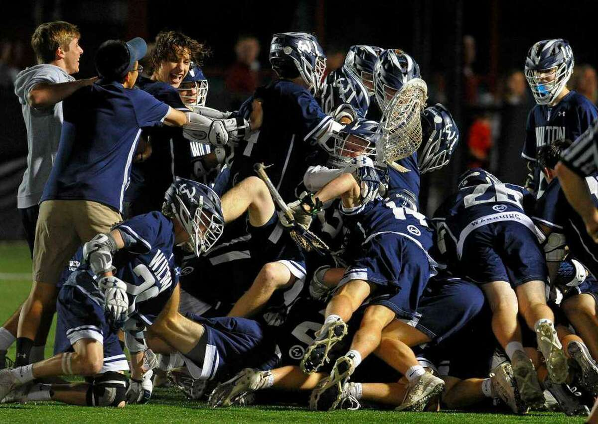 The Wilton boys lacrosse team celebrates its victory over Fairfield Prep in the state semifinals. The team has been chosen as one of the Fairfield County Sports Commission's Sports Persons of the Year.