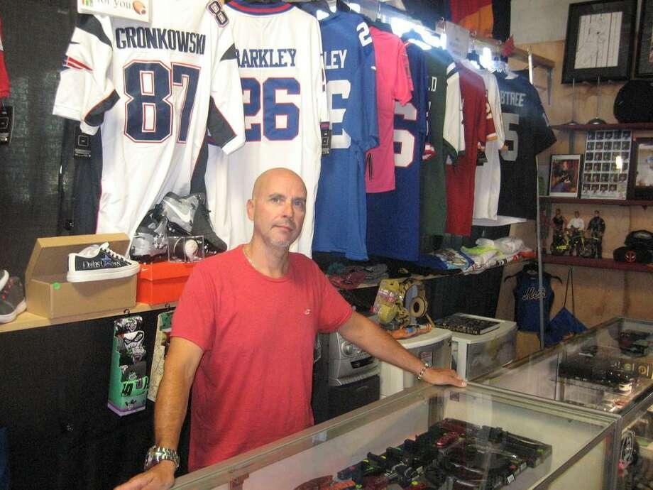 Vendor Jesse Spaar in his space at the New Brunswick Indoor Flea Market in Torrington. Photo: John Torsiello /
