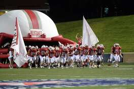 The Mustangs take the field for the third quarter of a high school football game between the Seven Lakes Spartans and the Memorial Mustangs on Thursday August 30, 2018 at Tully Stadium, Houston, TX.