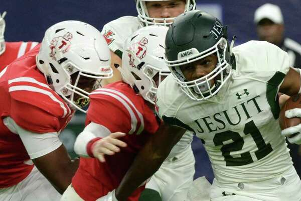 Michael Wiley (21) of Strake Jesuit breaks a tackle on the way to a 27 yard gain and first down in the first quarter of a high school football game between the Strake Jesuit Crusaders and the St. Thomas Eagles on Friday, August 31, 2018 at NRG Stadium, Houston, TX.