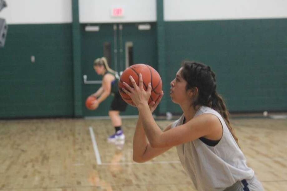 Anselma Barnett works on her free-throw shooting.