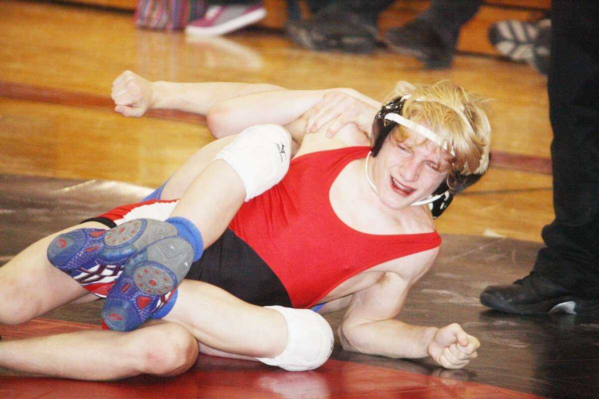 PIN HIM: Thayne Stieg of Reed City battles Sean Stenzel of Mason County Central in a 130-pound match Saturday at the Reed City Invitational.(Herald Review photo/John Raffel)