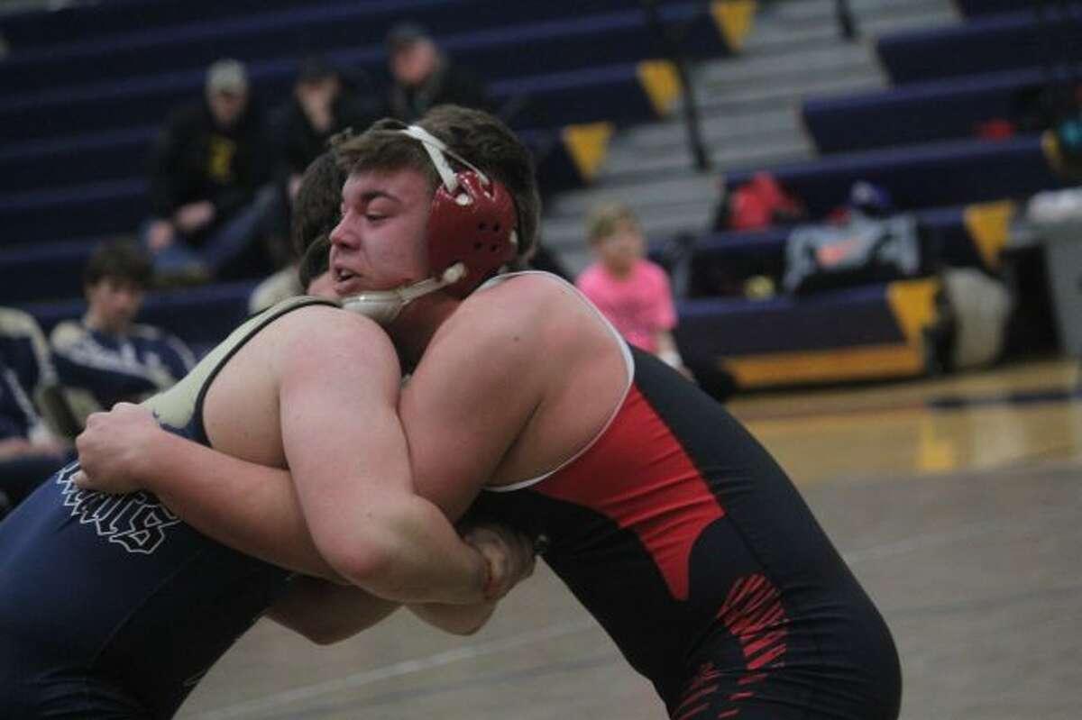Brett Walker (right) is among Reed City's top wrestlers.
