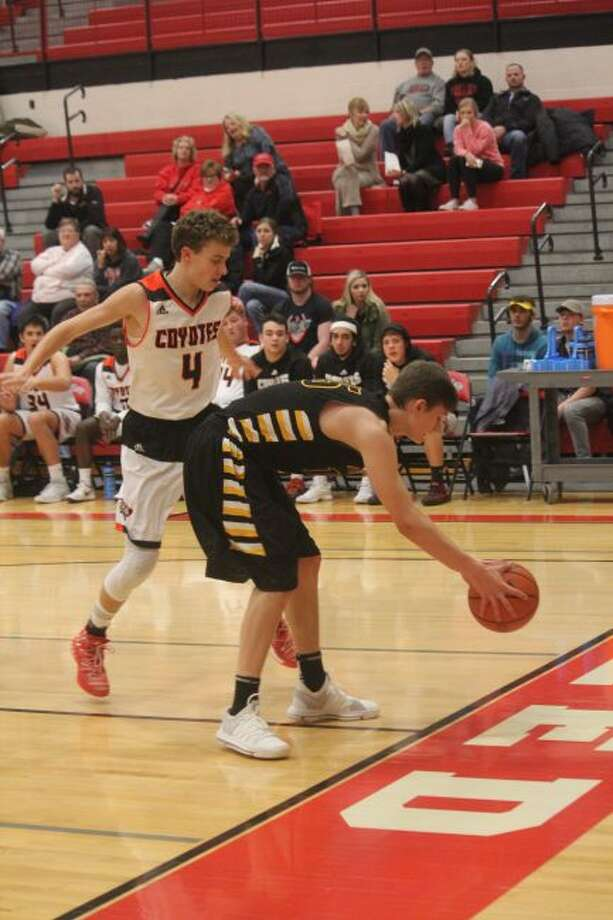 Brandon Wirth (4) looks to make the defensive play for Reed City.