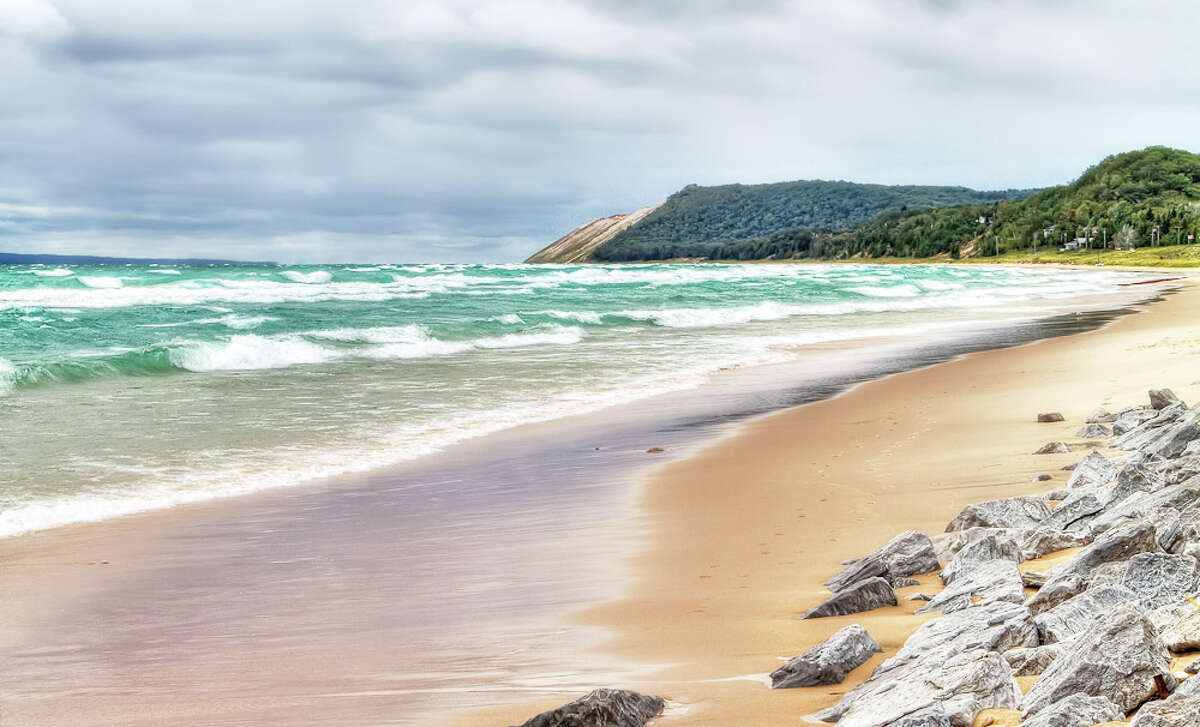 """SLEEPING BEAR DUNES: A must-see park. Covering 35 miles of beach on Michigan's lower peninsula, the Sleeping Bear Dunes were named Most Beautiful Place in America by """"Good Morning America."""" (Courtesy photo)"""