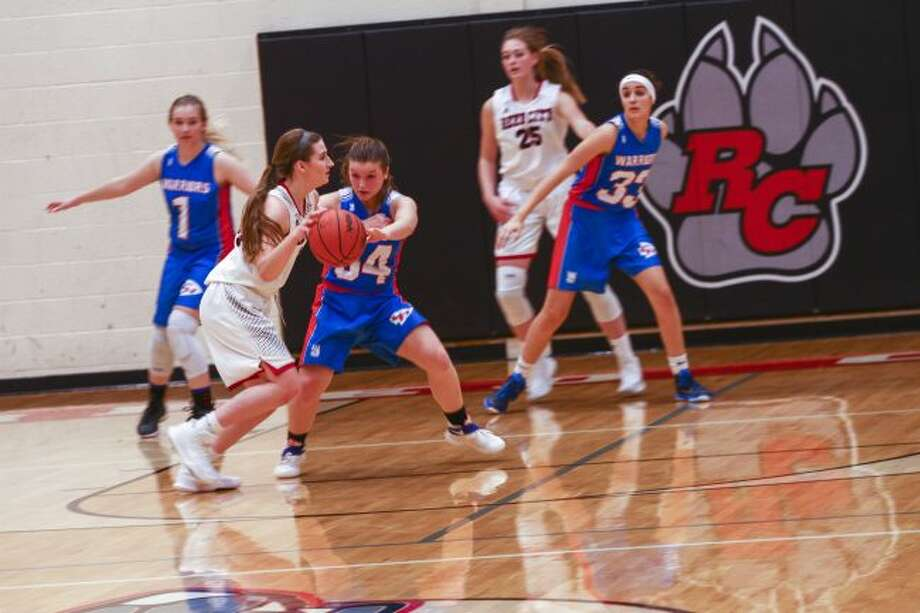 Emily Libey drives to the basket.