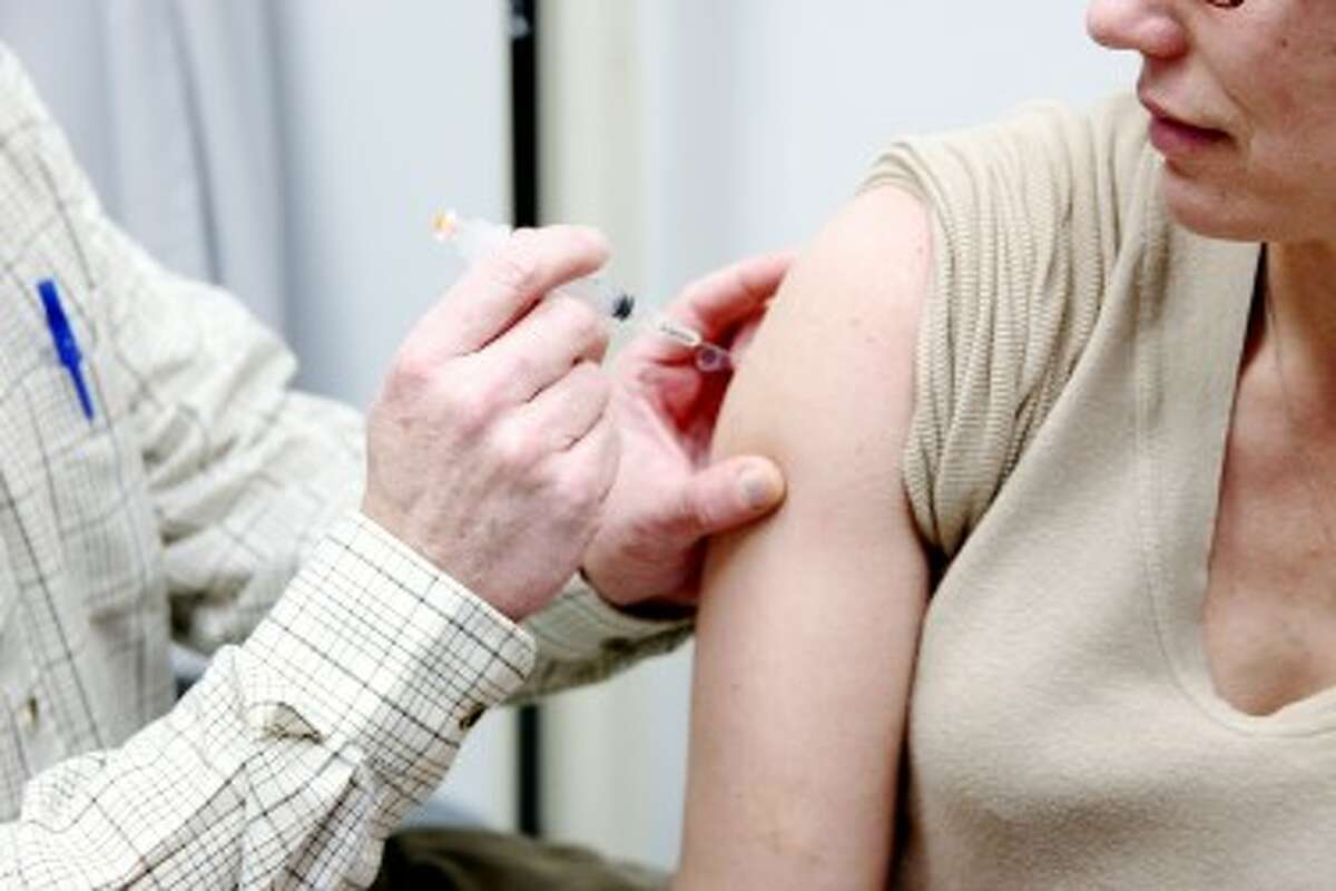 VACCINATION: District Health Department No. 10 in Mecosta County offers three types of flu vaccinations. (From back to front) A general influenza vaccine dose is offered to adults, anyone 49 years old and younger can opt for a nasal mist vaccination and infants receive a pediatric dose. (Pioneer photos/Lauren Fitch)