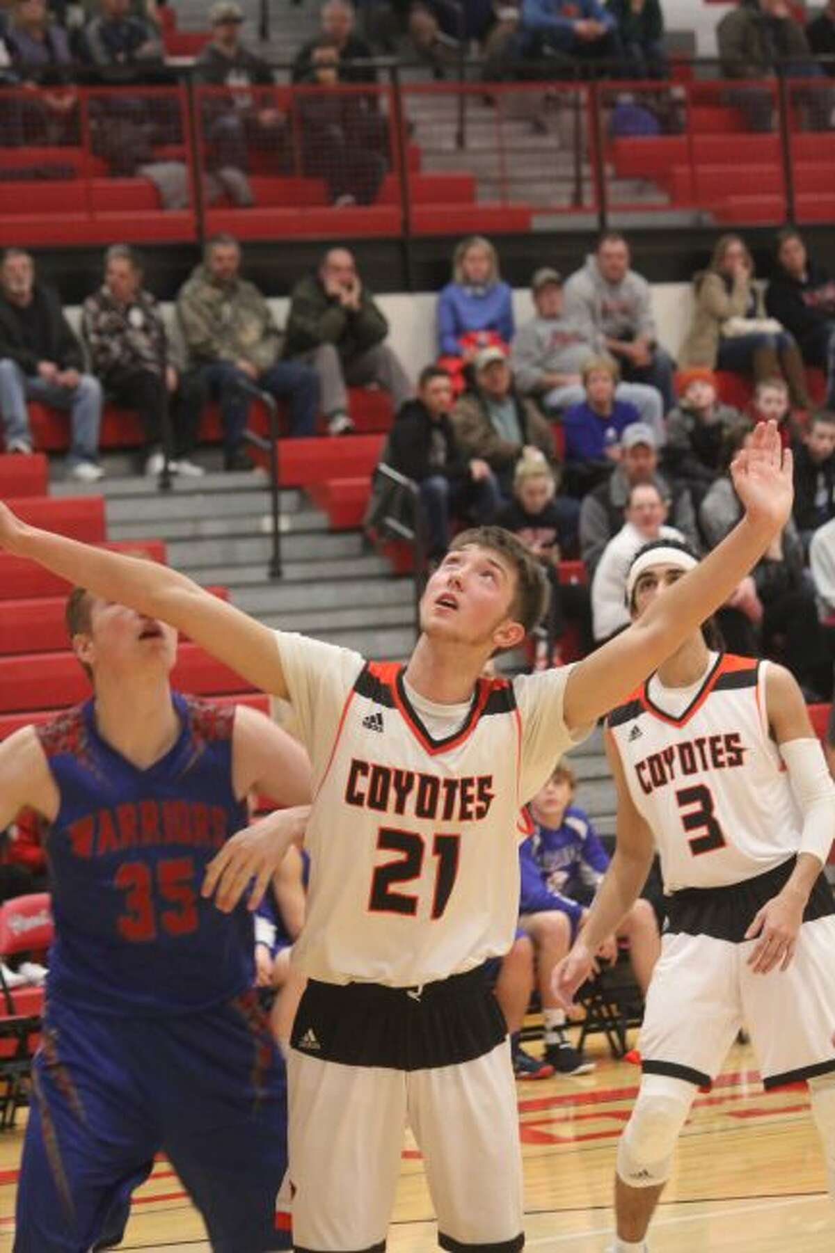 Cody Kailing (21) waits for a possible rebound.