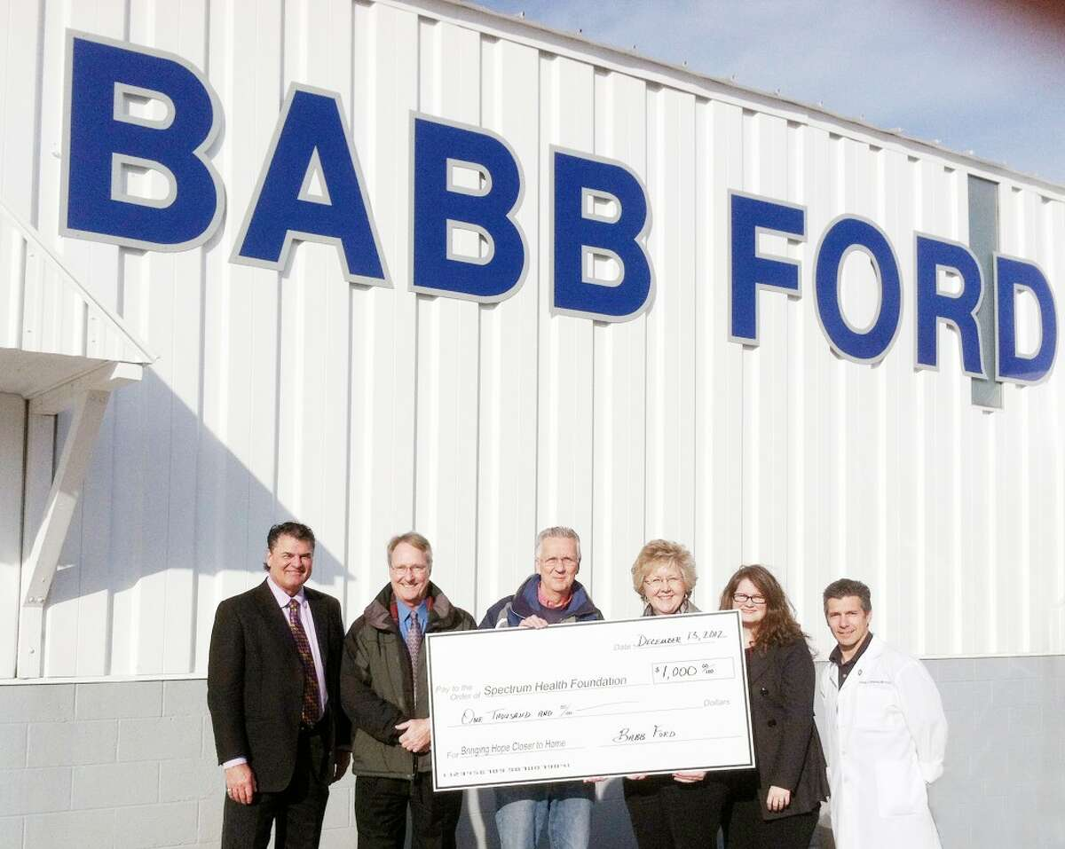 Donation: Pictured left to right: Bob Horan - General Manager, Babb Ford, Sam Daugherty- president, Spectrum Health Reed City Hospital, Ron Babb - owner, Babb Ford, Sue Snavley - marketing/public relations manager, Christie Carlson, development director and Dr.Tom Campana, chief of staff - Spectrum Health Reed City Hospital. (Courtesy photo)