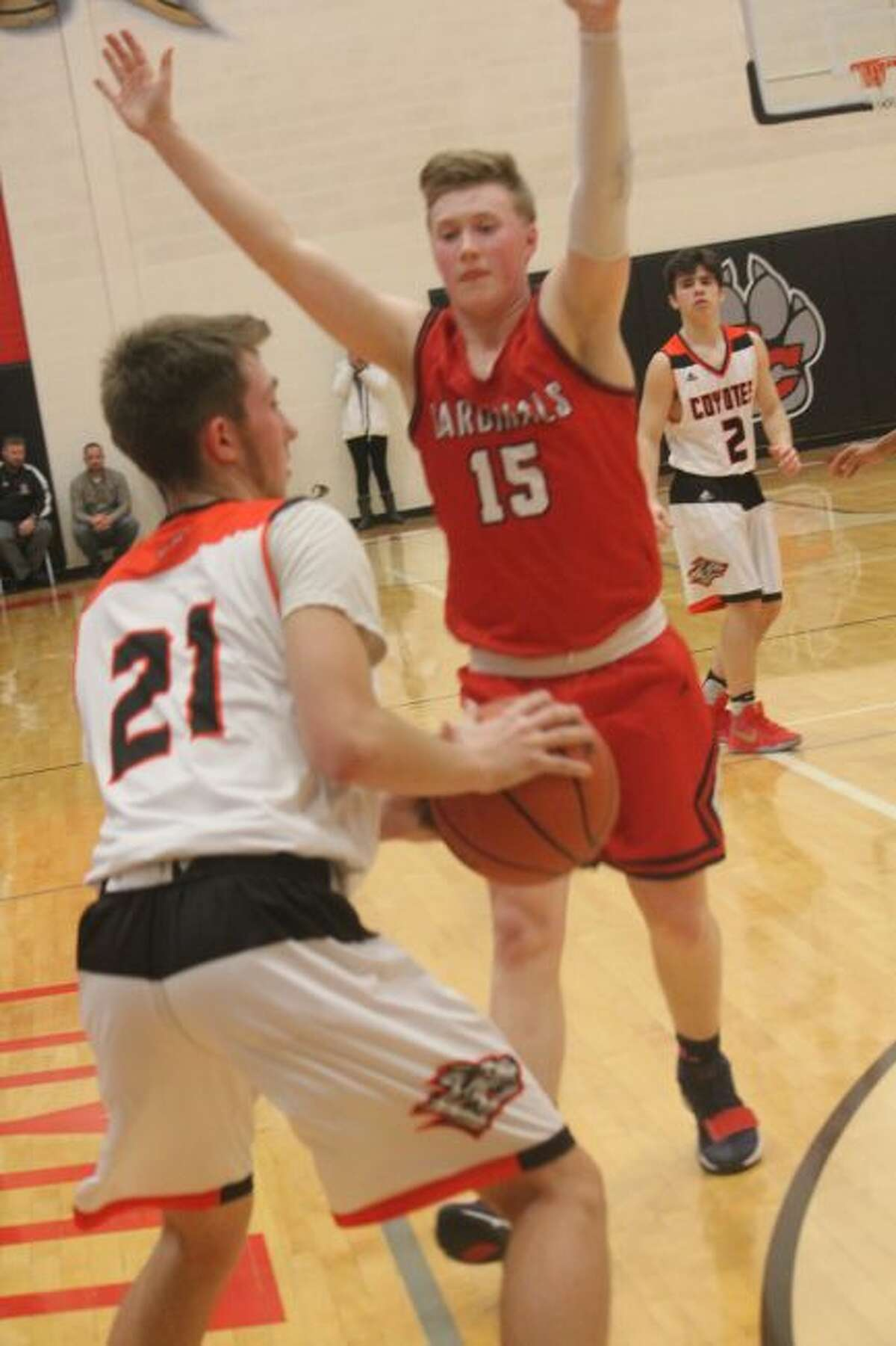 Cody Kailing (21) faces defense from Big Rapids' Jackson Lund.
