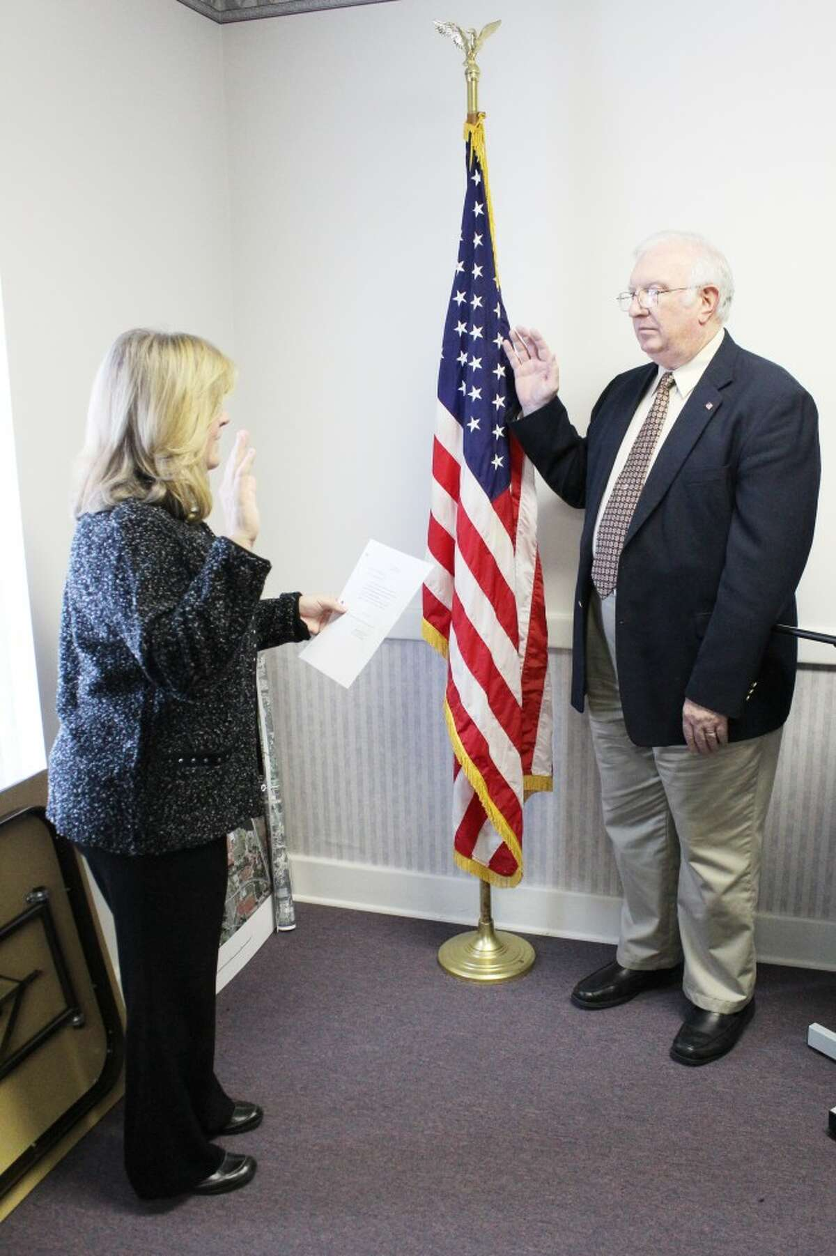 Prepared for the job: Ron Howell is sworn in as the interim city manager in Reed City. He is taking over after Ron Marek resigned in November.