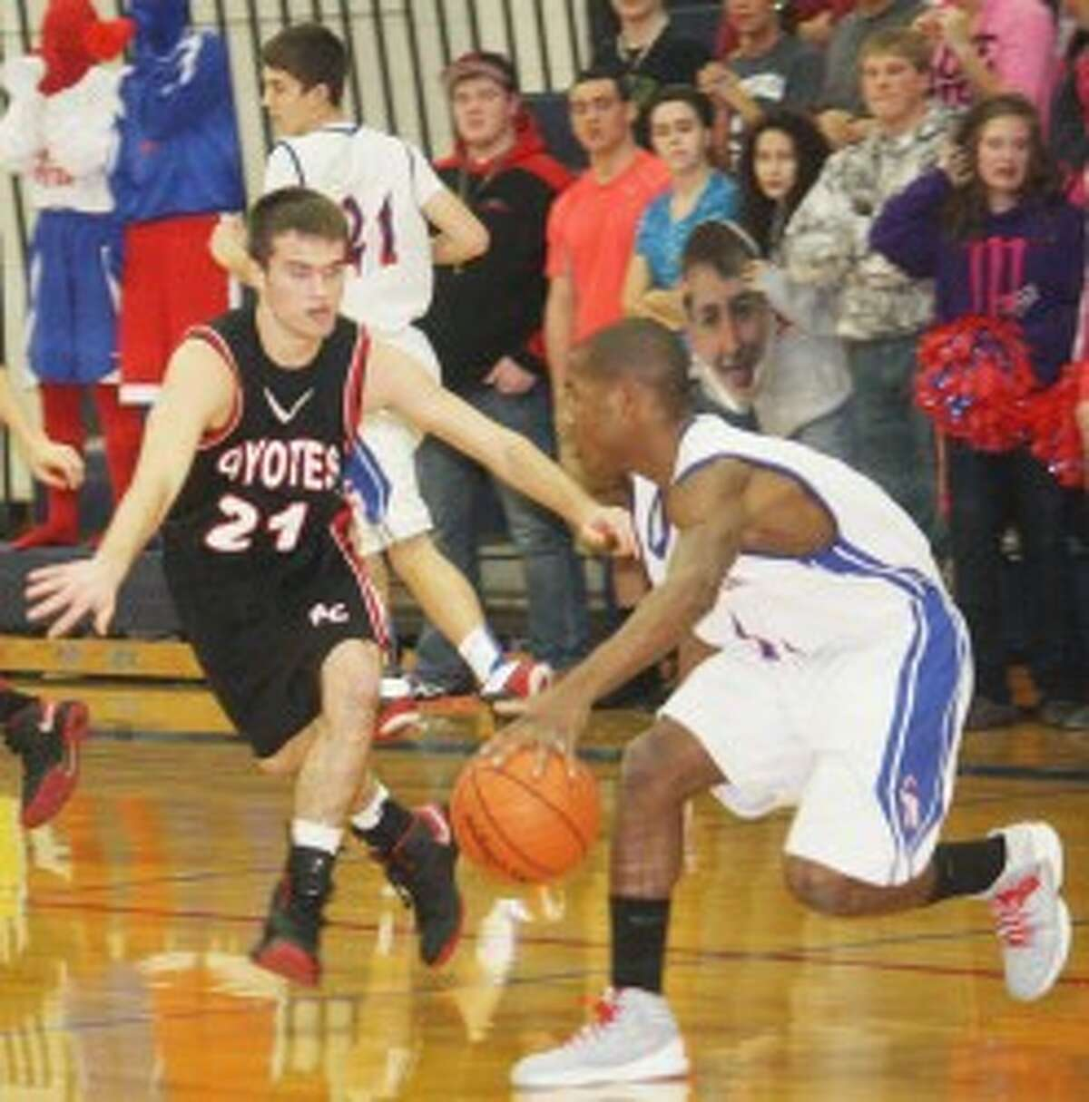 ON GUARD: Reed City's Chad Samuels (left) sticks with Chippewa Hills' Qunnell Key during Thursday's basketball action. (Pioneer photo/John Raffel)