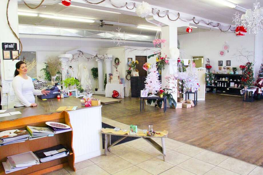 SPECIALTY STORE: The Secret Garden offers a variety of silk and fresh flower arrangements along with handmade crafts. The store is located at 110 E. 7th St. in Evart. (Herald Review photos/Sarah Neubecker)