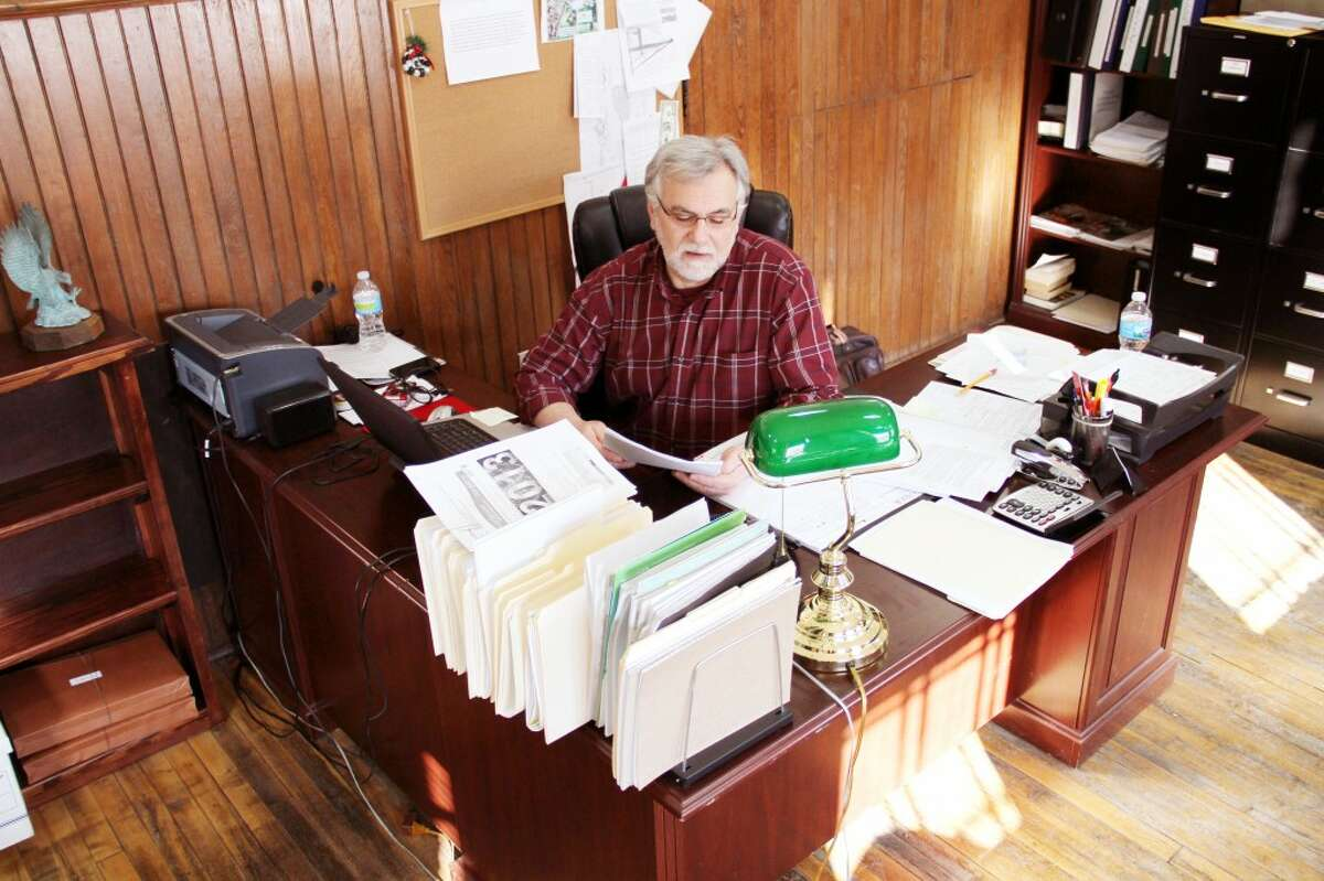 CHANGING ROLES: After more than 23 years in law enforcement and six years as Evart police chief, Zack Szakacs retired from the position on Jan. 1. With his extra time, Zsakacs will focus more heavily on his other role as the Evart city manager. (Herald Review photo/Sarah Neubecker)
