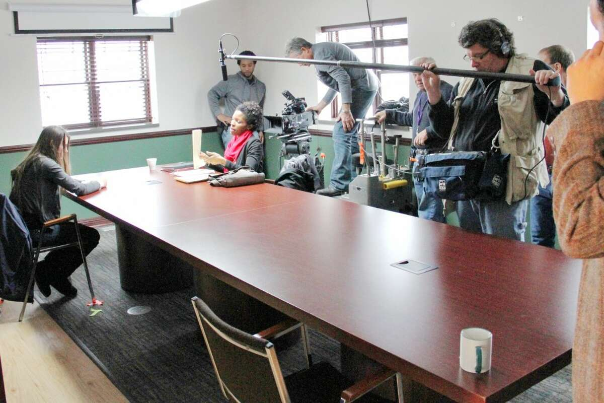 """LIGHTS, CAMERA, ACTION: A movie production crew films an interrogation scene for """"Chrysalis,"""" a short movie detailing the life of a 14-year-old girl making her way out of sex slavery. (Herald Review photo/Sarah Neubecker)"""