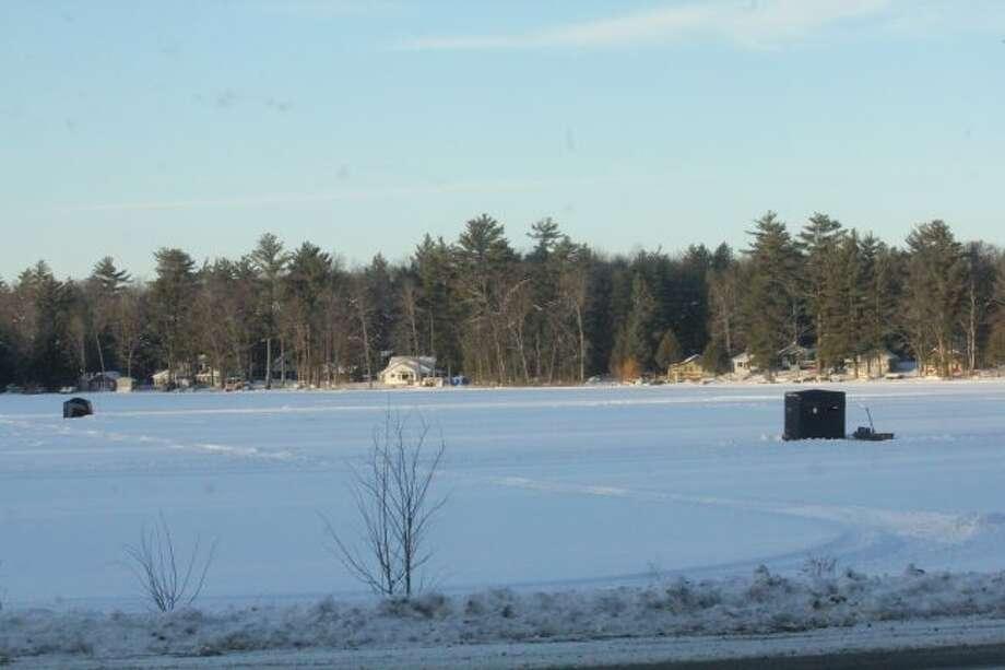 Shanties still sit on a Lake County lake.