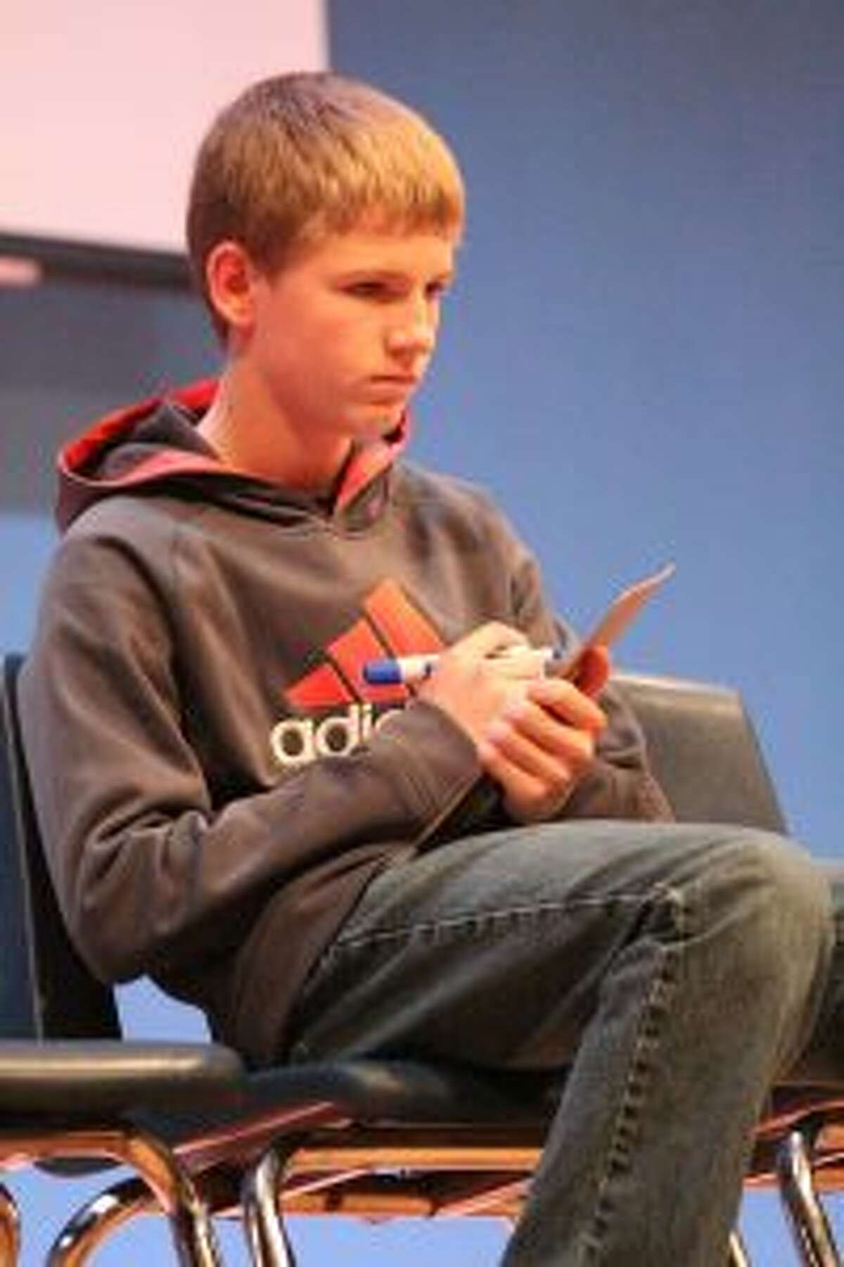 Evart Middle School eighth-grader Danny Witbeck writes his answer during the championship round of the geography bee on Jan. 31. Witbeck won the school's geography bee.