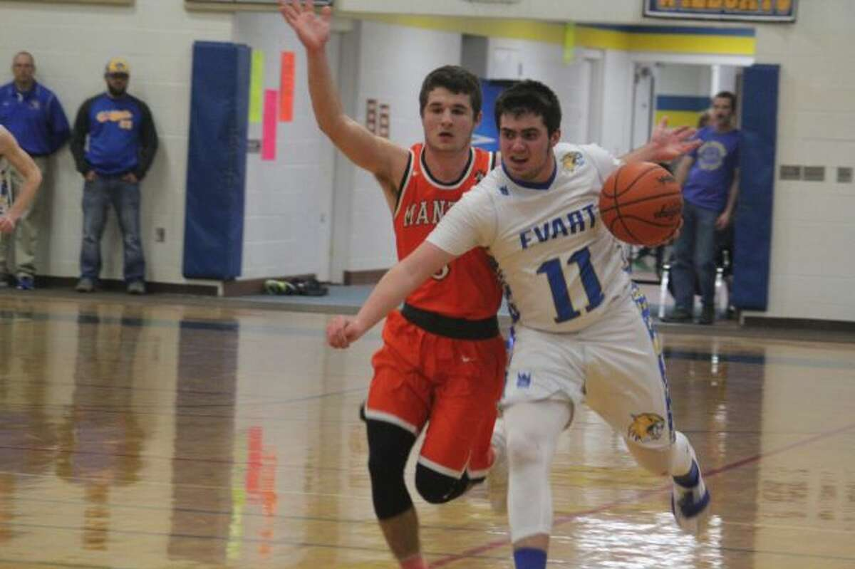 Cam Martin works with the ball for Evart.