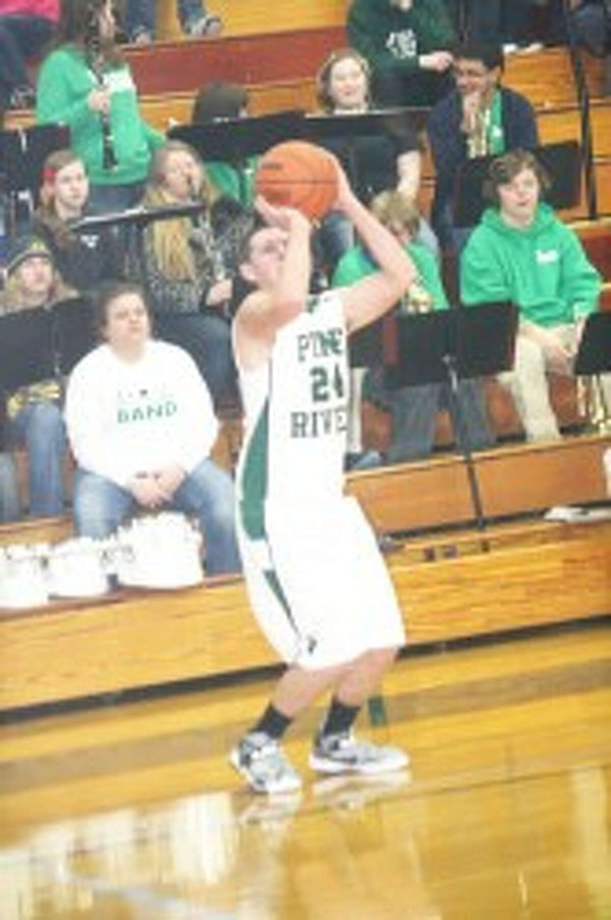 First loss: Tyler Lewis (24) takes a shot for Pine River. (Herald photo/John raffel)