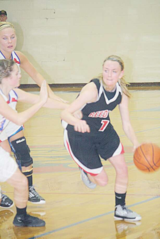 Rematch pressure: Emma Lockhart drives to the basket for Reed City in recent action. (Herald review/John Raffel)