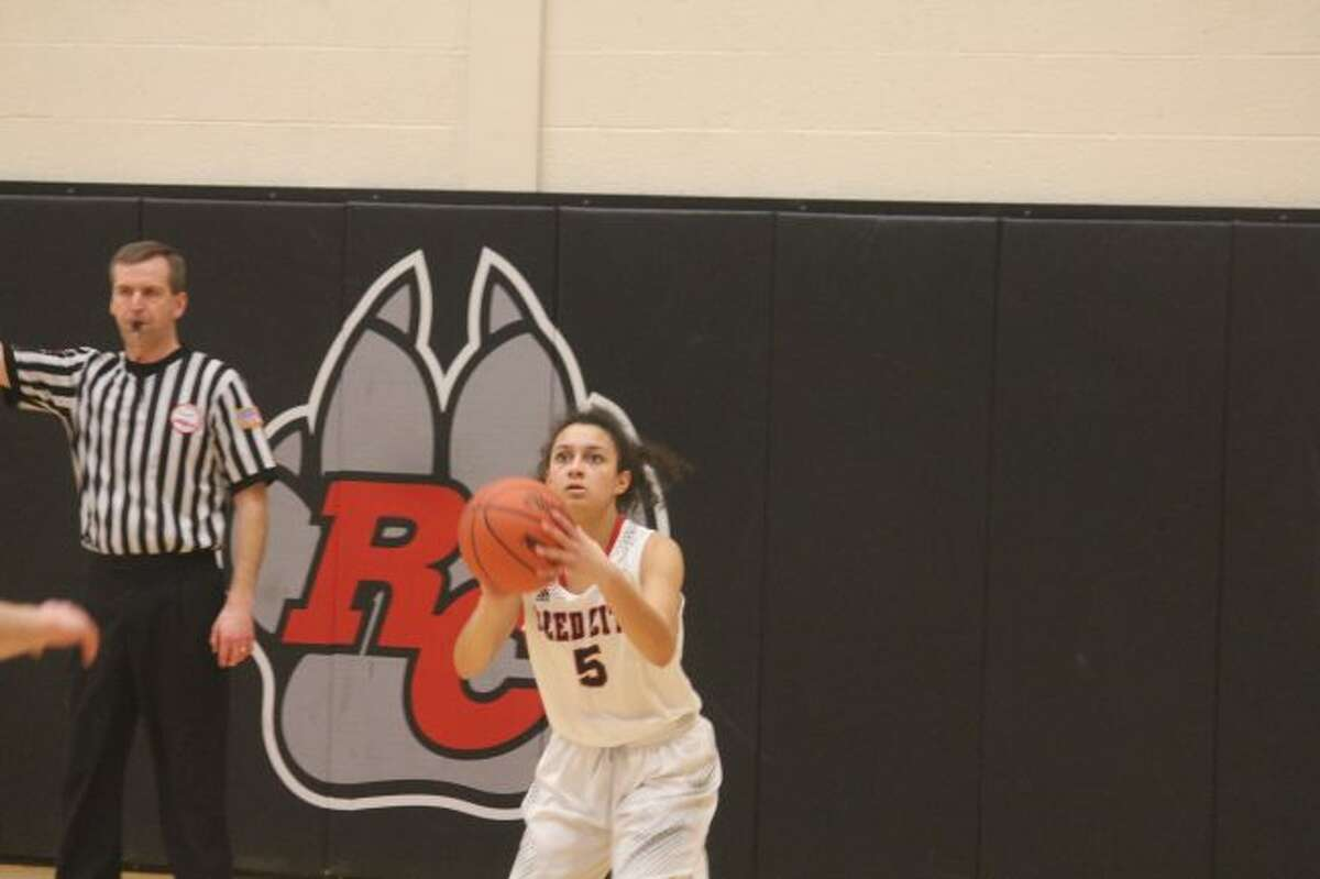 Reed City's Kiera Barker takes a shot in recent actiom.